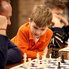 Five-year-old Ben Schmidt helps Brian Basich with his game during Family Chess Night at Geneva High School Tuesday night. The event was sponsored by the GHS Chess Club.