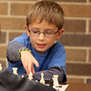 Andy Warcup, 8, plays a game of chess during Family Chess Night at Geneva High School Tuesday night. The event was sponsored by the GHS Chess Club.
