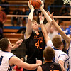 St. Charles East's Jack Bronec (40) tries to get a shot up during their game at Larkin Thursday.