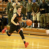 Cole Gentry of St. Charles East dribbles down court during their game at Larkin Thursday.