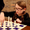 Sydney Brazener, 9, makes a move during Family Chess Night at Geneva High School Tuesday night. The event was sponsored by the GHS Chess Club.