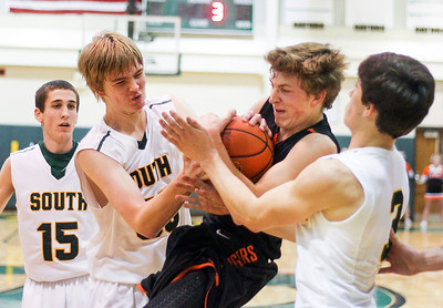 Sarah Nader- snader@shawmedia.com Crystal Lake South's Josh Friesem (left) fights for control of the ball with Crystal Lake Central's Kevin Peisker during the third quarter of Saturday's game in Crystal Lake December 7, 2013.