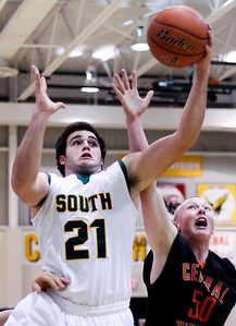 Sarah Nader- snader@shawmedia.com Crystal Lake South's Austin Rogers (left) is guarded by Crystal Lake Central's Ian Koch while he shoots during the first quarter of Saturday's game in Crystal Lake December 7, 2013.