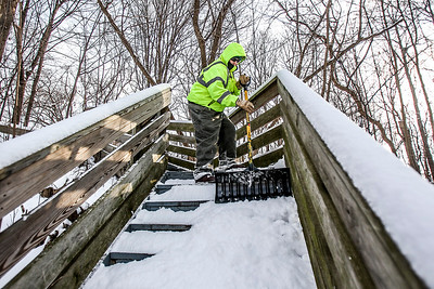 Sarah Nader- snader@shawmedia.com Mark Trebes with the McHenry County Conservation District clears steps leading to Prairie Trail in Algonquin Monday, December 9, 2013 after McHenry County had its first significant measurable snowfall of the winter season. The National Weather Service in Chicago recorded 3.1 inches of snowfall at O'Hare International Airport Sunday and some weather spotters reported more than 4 inches of snow in McHenry and Crystal Lake.