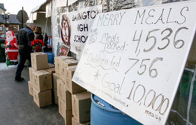 Jeff Krage – For Shaw Media Merry Meals for Guatamala, which was put together by the Barrington High School Interact Club, was hoping to pack 10,000 meals during the Christkindl Festival in downtown Barrington over the weekend. Barrington 12/7/13