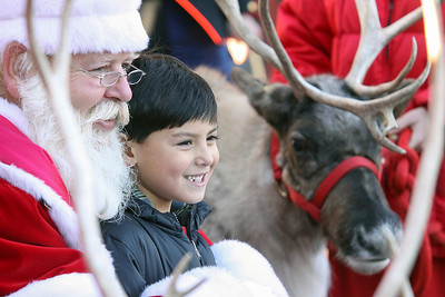 Jeff Krage – For Shaw Media AJ Albandia, 5, of Schaumburg smiles Saturday for a photo with Santa and his reindeer at the Arboretum of South Barrington. South Barrington 11/30/13