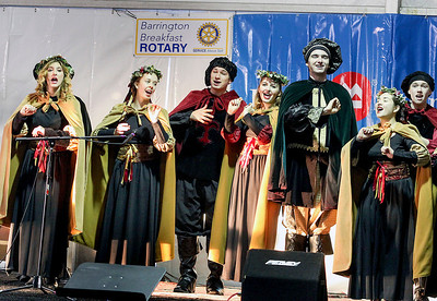 Jeff Krage – For Shaw Media The Barrington High School Madrigal Singers perform during Saturday's Christkindl Festival in downtown Barrington. Barrington 12/7/13