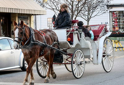 Jeff Krage – For Shaw Media Free carriage rides were part of Saturday's Christkindl Festival in downtown Barrington. Barrington 12/7/13