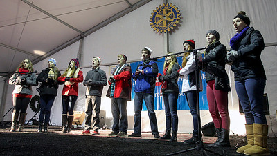 Jeff Krage – For Shaw Media The Barrington High School Carolers perform during Saturday's Christkindl Festival in downtown Barrington. Barrington 12/7/13