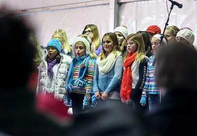 Jeff Krage – For Shaw Media The Barrington Children Choir sing holiday favorites during Saturday's Christkindl Festival in downtown Barrington. Barrington 12/7/13