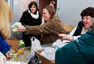 Kyle Grillot - kgrillot@shawmedia.com   Parents and second-grade teachers including Jennifer DeBlok (top right), Lisa MicklingHoff (center), and Cheri Ryba (right) unload groceries at the FISH Food Pantry Monday in McHenry. Riverwood second-graders donated $600 worth of groceries as part of the Kids Give Back curriculum, courtesy of Peapod an online grocery delivery service. The FISH Food Pantry provides upward of 12,000 pounds of food to 600 local families in need each week.