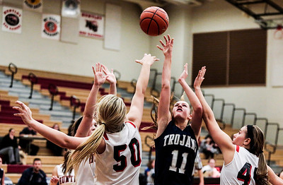 Kyle Grillot - kgrillot@shawmedia.com   Heavily guarded Cary-Grove junior Candace Cunningham puts up a shot during the fourth quarter of the girls high school basketball game Monday in Huntley. Huntley won the game 58-48.