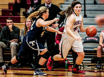 Kyle Grillot - kgrillot@shawmedia.com   Huntley senior Samantha Andrews (right) dribbles towards the net under the defense of Cary-Grove junior Maddie Priester during the third quarter of the girls high school basketball game Monday in Huntley. Huntley won the game 58-48.