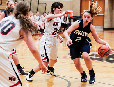 Kyle Grillot - kgrillot@shawmedia.com   Cary-Grove junior Katie Barker (2) dribbles towards the net under the defense of Huntley senior Bethany Zornow during the fourth quarter of the girls high school basketball game Monday in Huntley. Huntley won the game 58-48.