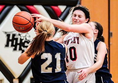 Kyle Grillot - kgrillot@shawmedia.com   Heavily guarded Huntley senior Samantha Andrews (40) loses control of the ball during the fourth quarter of the girls high school basketball game Monday in Huntley. Huntley won the game 58-48.