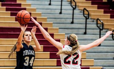 Kyle Grillot - kgrillot@shawmedia.com   Cary-Grove junior Chrissy Sopchyk (34) passes the ball under the defense of Huntley sophomore Paige Renkosik during the third quarter of the girls high school basketball game Monday in Huntley. Huntley won the game 58-48.