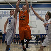 St.Charles East's James McQuillan (22) puts up a shot against St.Charles North's Ryan Bagnell (21) at St.Charles North High School in St.Charles, IL on Saturday, December 07, 2013 (Sean King for Shaw Media)
