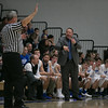 St.Charles North's head coach Tom Poulin talks to an official during a break in play at St.Charles North High School in St.Charles, IL on Saturday, December 07, 2013 (Sean King for Shaw Media)