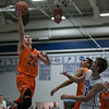 St.Charles East's James McQuillan (22) drives to the hoop against St.Charles North at St.Charles North High School in St.Charles, IL on Saturday, December 07, 2013 (Sean King for Shaw Media)