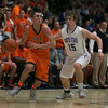 St.Charles East's Dom Adduci (2) drives baseline against St.Charles North's Erik Miller (15) at St.Charles North High School in St.Charles, IL on Saturday, December 07, 2013 (Sean King for Shaw Media)
