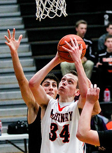 Sarah Nader- snader@shawmedia.com McHenry's Nick Higgin shoots during the third quarter of Tuesday's game against Woodstock North in McHenry December 10, 2013. McHenry won, 60-50.