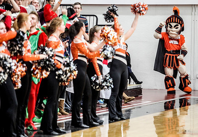 Sarah Nader- snader@shawmedia.com The McHenry Warrior mascot pumps up the crowd during a boys basketball game against Woodstock North Tuesday, December 10, 2013.