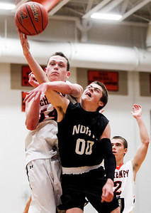 Sarah Nader- snader@shawmedia.com McHenry's Nick Higgin guards Woodstock North's Josh Jandron while he shoots during the third quarter of Tuesday's game in McHenry December 10, 2013. McHenry won, 60-50.