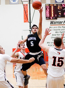 Sarah Nader- snader@shawmedia.com Woodstock North's Leonel Ortiz shoots during the second quarter of Tuesday's game against McHenry in McHenry December 10, 2013. McHenry won, 60-50.