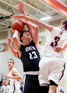 Sarah Nader- snader@shawmedia.com Woodstock North's Drake Creighton (left) is blocked by McHenry's Cody Freund during the second quarter of Tuesday's game in McHenry December 10, 2013. McHenry won, 60-50.
