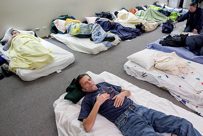 Sarah Nader- snader@shawmedia.com Jim Kunatz gets ready for bed while sleeping at the PADS shelter at Redeemer Lutheran Church in Woodstock Wednesday, December 11, 2013. Kunatz has been homeless since last October.