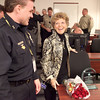 Lorraine Stahl of the Mill Creek Neighborhood Watch organization is congratulated by Kane County Undersheriff Dave Wagner after Stahl received the Roscoe Ebey Citizen of the Year award at the Kane County Sheriff's office Thursday morning.