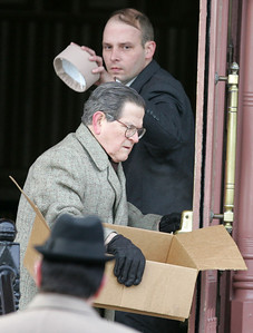 """H. Rick Bamman -hbamman@shawmedia.com Dismissed bell boy played by Tim Kazurinsky leaves the hotel during filming of a scene in the Chris Parrish directed film """"Night at the Amusement Park,"""" Monday, Dec. 16, 2013."""
