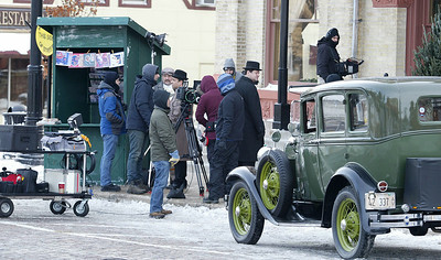 """H. Rick Bamman -hbamman@shawmedia.com The cast and crew of the film """"Night at the Amusement Park,"""" prepare to rehears a scene Monday, Dec. 16, 2013 in front of the Woodstock Opera House. The film is directed by Chris Parrish, a Woodstock High School graduate."""