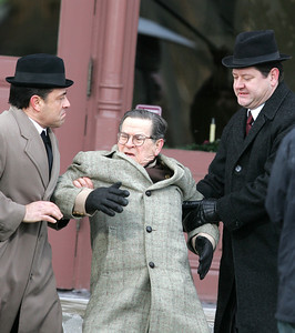 """H. Rick Bamman -hbamman@shawmedia.com A dismissed bell boy played by Tim Kazurinsky (center) is roughed up by thugs in front of a hotel in a scene from """"Night at the Amusment Park,"""" directed by Chris Parrish, a Woodstock High School graduate."""