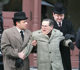 """H. Rick Bamman -hbamman@shawmedia.com A dismissed bell boy, played by Tim Kazurinsky (center) is roughed up by thugs in front of a hotel during the filming of the film """"Night at the Amusement Park,"""" Monday, Dec. 16, 2013 at the Woodstock Opera House. The film is directed by Woodstock High School graduate Chris Parrish. Parrish has also written for """"The King of Queens,"""" and Disney Channel's """"American Dragon: Jake Long."""" Parrish trained at Chicago's Second City."""
