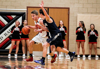 Sarah Nader- snader@shawmedia.com Huntley's Trevor Oslance (left) is guarded by Cary-Grove's Devin McDonough wile he brings the ball down court during the fourth quarter of Tuesday's game in Huntley December 17, 2013. Huntley defeated Cary-Grove, 58-25.