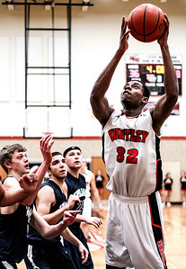 Sarah Nader- snader@shawmedia.com Huntley's Amanze Egekeze takes a shot during the third quarter of Tuesday's game against Cary-Grove in Huntley December 17, 2013. Huntley defeated Cary-Grove, 58-25.