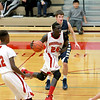 Mooseheart's Mangisto Deng (24) dribbles down court during their home game against Harvest Christian Academy Tuesday night.