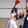 Mooseheart's Hameed Odunewu passes the ball during their home game against Harvest Christian Academy Tuesday night.