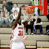 Mooseheart's Makur Puou (32) dunks the ball during their home game against Harvest Christian Academy Tuesday night.