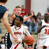 Mooseheart's Freddy Okito goes up for a shot during their home game against Harvest Christian Academy Tuesday night.