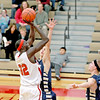 Mooseheart's Makur Puou (32) shoots the ball during their home game against Harvest Christian Academy Tuesday night.