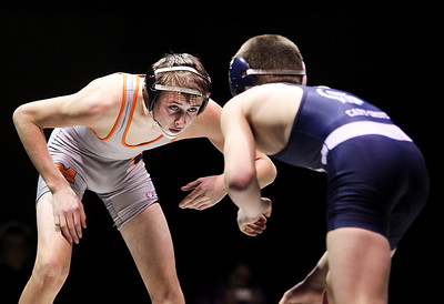 Sarah Nader- snader@shawmedia.com McHenry's Robbie Duh (left) wrestles Cary-Grove's Sean Cullen in the 126- pound match Thursday, December 19, 2013. McHenry won the dual 32-29.
