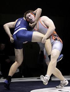 Sarah Nader- snader@shawmedia.com Cary-Grove's Ben Glasder (left) fights to take down McHenry's Ryan Grannamann in the 195- pound match Thursday, December 19, 2013. McHenry won the dual 32-29.