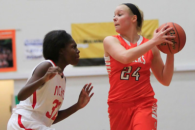 Candace H. Johnson Crystal Lake Central's Kristen Bernero looks to drive around North Chicago's Tineesha Coleman in the third quarter during the Northern Illinois Girls Holiday Classic tournament at McHenry West High School.