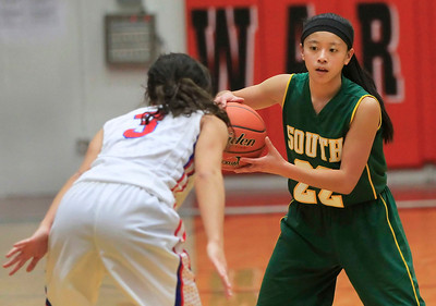 Candace H. Johnson Crystal Lake South's Gaby De Jesus keeps an eye on Dundee-Crown defender, Francesca Scarpelli, in the third quarter during the Northern Illinois Girls Holiday Classic at McHenry West High School. Crystal Lake South won 56-48.