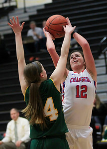 Candace H. Johnson Crystal Lake South's Chanel Fanter blocks a shot by Dundee-Crown's Lauren Lococo in the second quarter during the Northern Illinois Girls Holiday Classic at McHenry West High School. Crystal Lake South won 56-48.