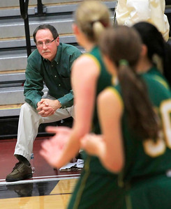 Candace H. Johnson Crystal Lake South's Joe Komaromy, assistant coach, keeps an eye on his girls varsity basketball team as they play against Dundee-Crown in the fourth quarter during the Northern Illinois Girls Holiday Classic tournament at McHenry West High School.