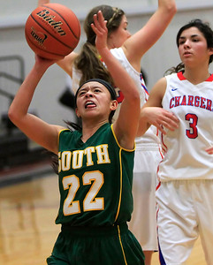 Candace H. Johnson Crystal Lake South's Gaby De Jesus looks up for a shot after getting past Dundee-Crown's Francesca Scarpelli in the fourth quarter during the Northern Illinois Girls Holiday Classic at McHenry West High School. Crystal Lake South won 56-48.