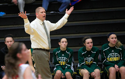 Candace H. Johnson Crystal Lake South's Kyle McCaughn, head coach, reacts from the sidelines during the girls varsity basketball game against Dundee-Crown at the Northern Illinois Girls Holiday Classic tournament at McHenry West High School.